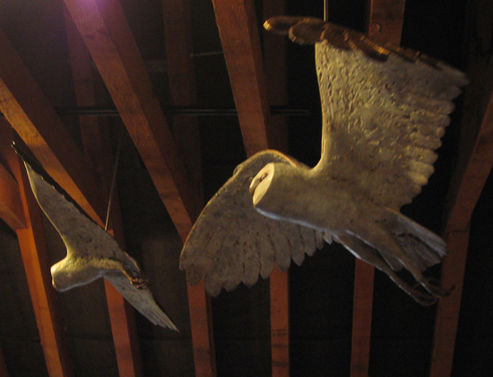 Pair of Barn Owl sculptures, bronze, hanging in a barn, Acton Court